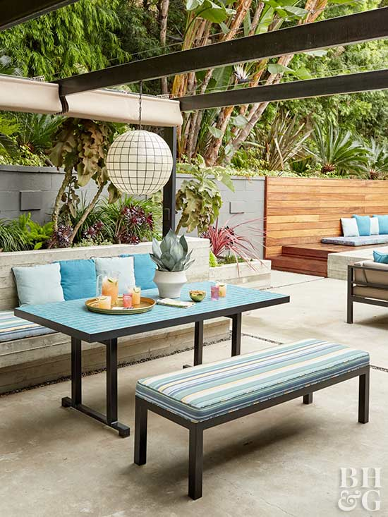 blue outdoor dining area with pergola