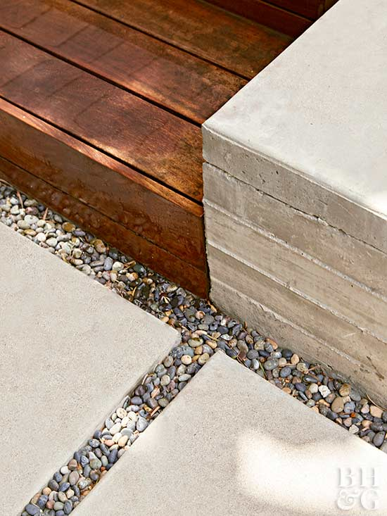 concrete and paver walkway with pebbles