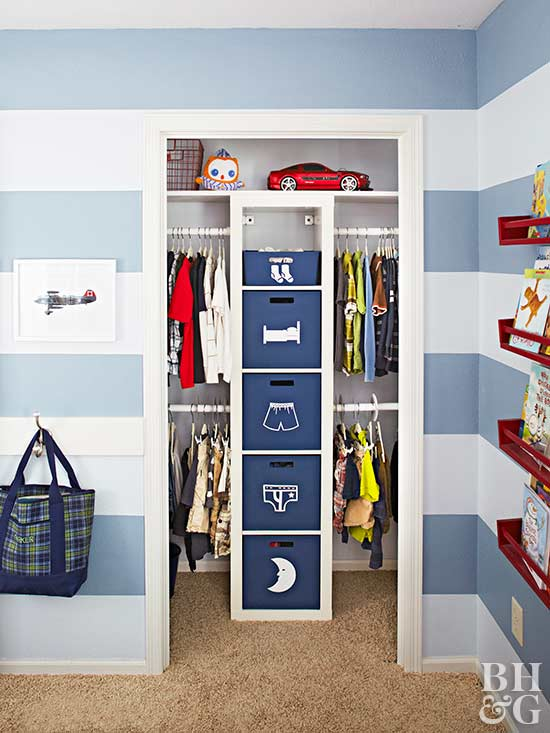 boys blue room with stripes and closet cubes