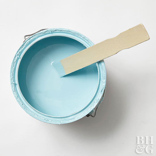 light blue primer open can with stir stick
