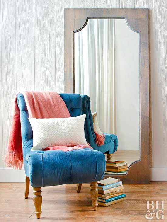 framed mirror and chair