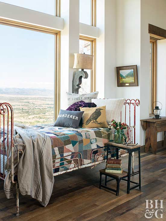 rustic daybed beside picture window