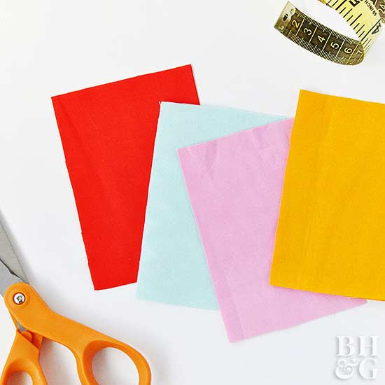 heating pad fabric pieces, scissors and measuring tape