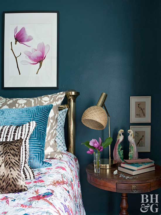 bed and nightstand with teal wall