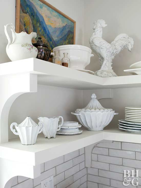 white kitchen shelves with vintage dishes