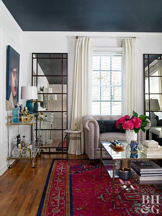 glam living room with dark ceiling