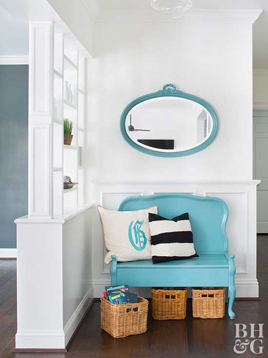 blue love seat with blue oval mirror