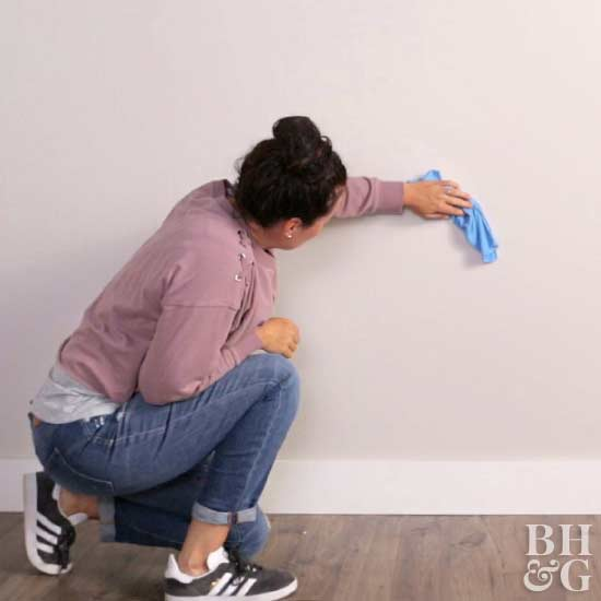 using cloth to wipe wall