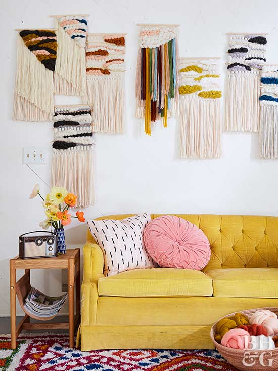 yellow sofa with yarn wall hangings