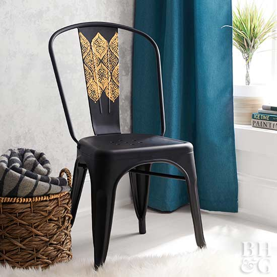 black metal chair with gold paint