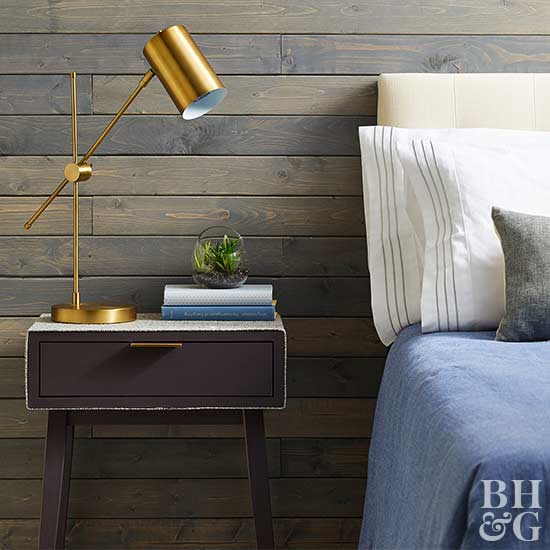 bedroom with lamp, nightstand, pillows, books