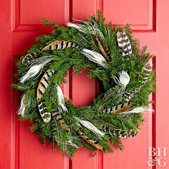 feather wreath hung on red front door