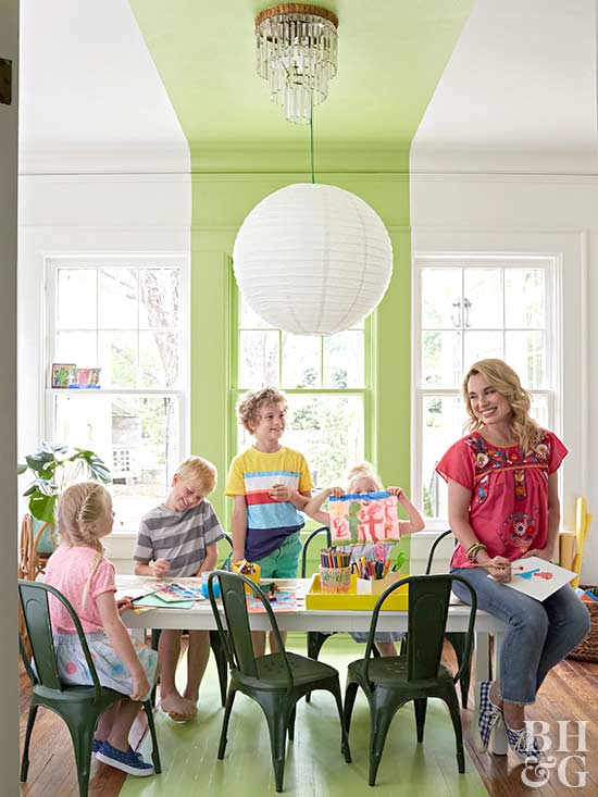 woman and children in green playroom