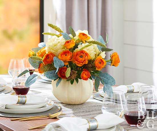 thanksgiving table pumpkin centerpiece with flowers