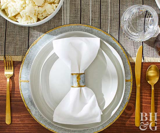 thanksgiving place setting with gold silverware