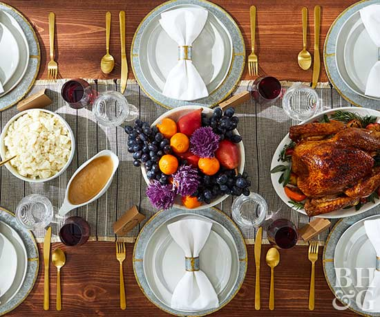 set thanksgiving table with fruit center piece turkey and gravy