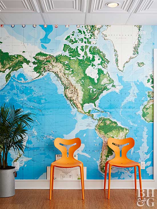 world map wallpaper and orange chairs