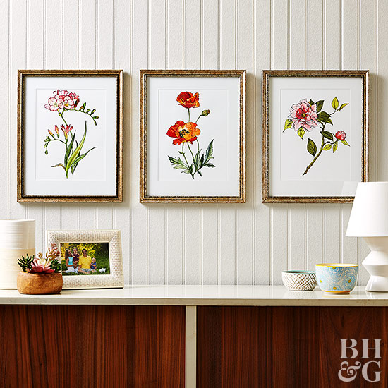 floral art in gold frames