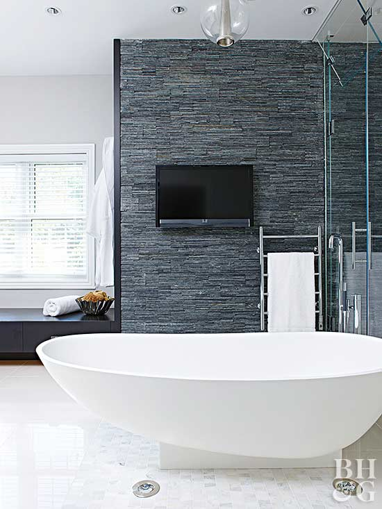 modern bathroom with large white tub and slate tile