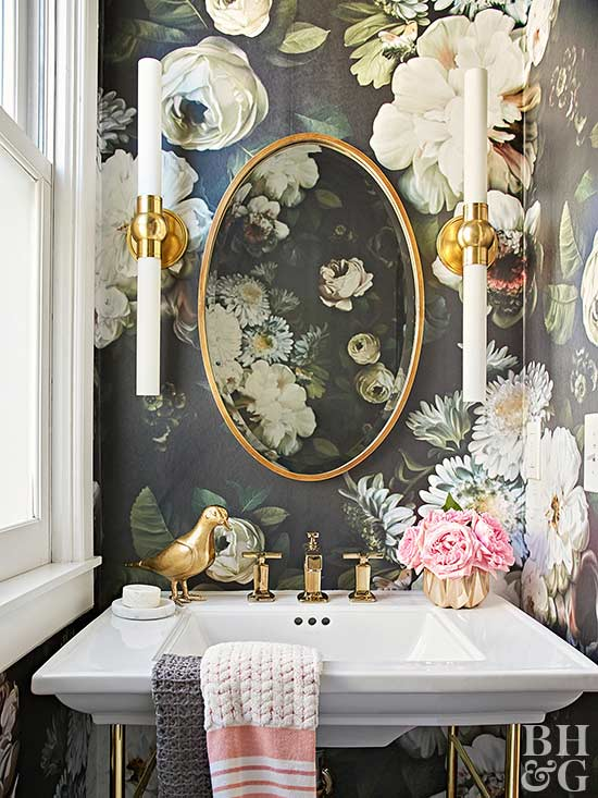 floral wallpaper in half bath with gold accents