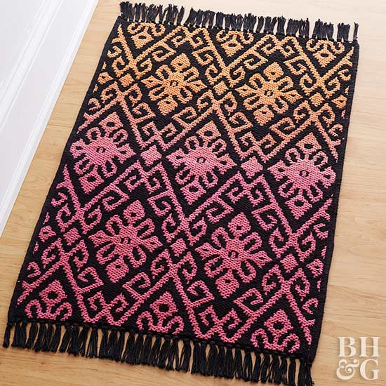orange pink and black damask pattern throw rug