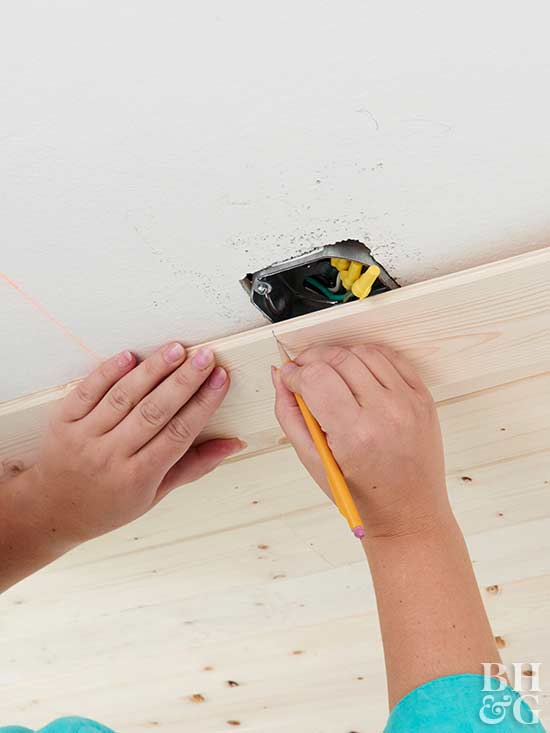 cutting a hole in ceiling planks