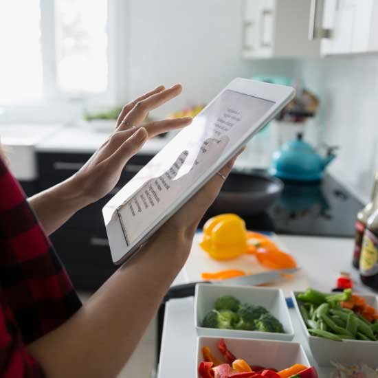woman on tablet in kitchen
