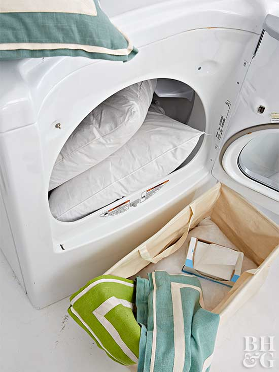dryer with pillows and laundry basket