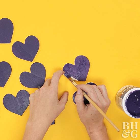 painting paper hearts purple