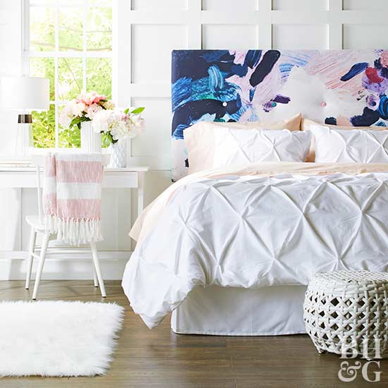 bedroom with decorative headboard