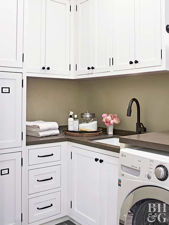 laundry room, washer, white cabinets