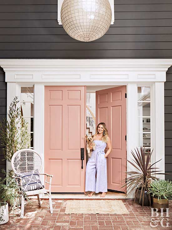 hilary duff and dog outside modern home