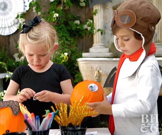 children decorating pumpkins
