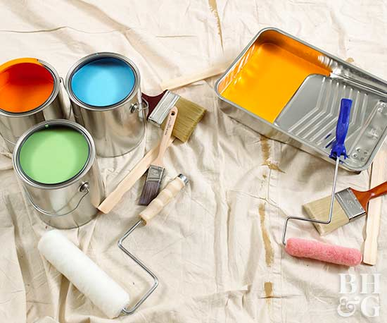 paint supplies and bright paint on drop cloth