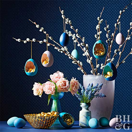 vase of pussy willow branches with painted egg ornaments