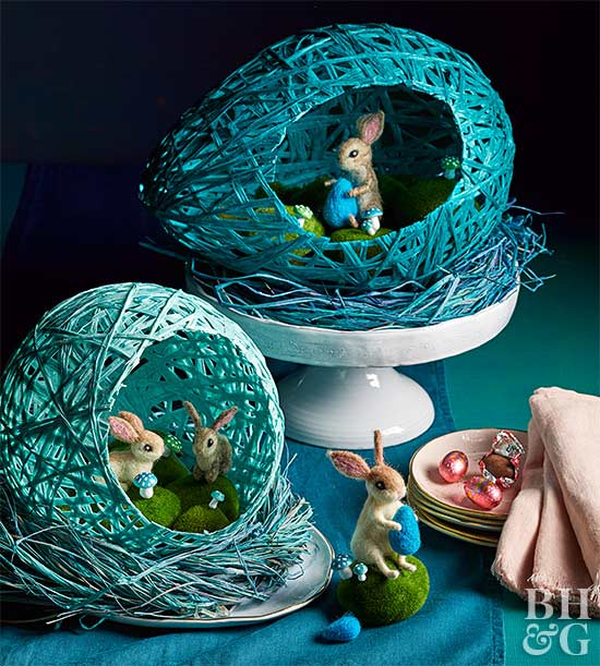 blue dyed raffia nests on cake stand