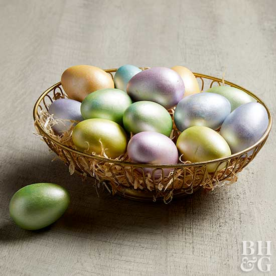 colorful metallic eggs in gold basket