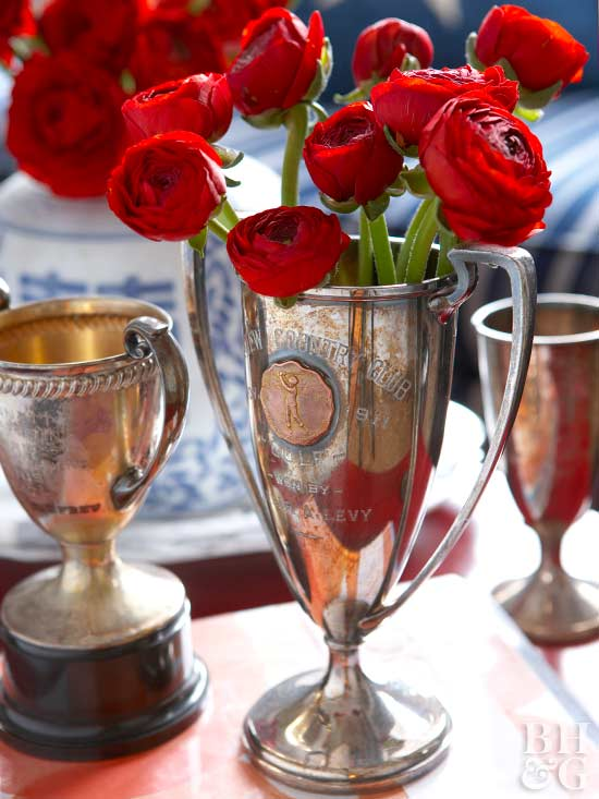 trophy decor with ranunculus on table