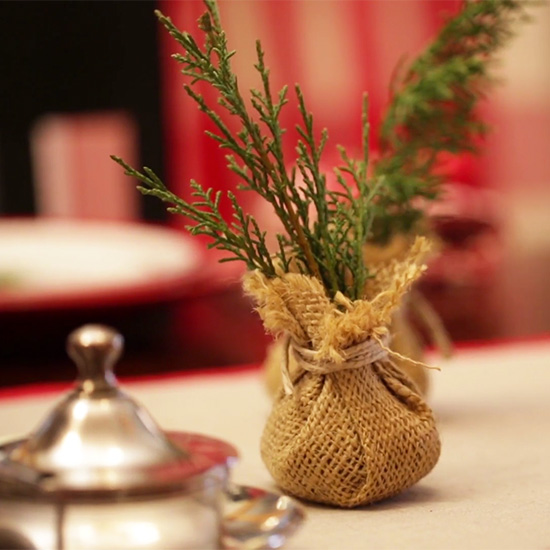 fir cuttings in burlap tabletop tree