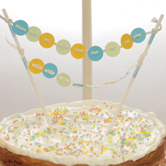 paper button banner cake with white frosting