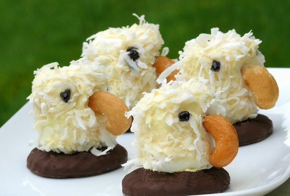 four marshmallow eagles on plate with coconut feathers cashew beaks