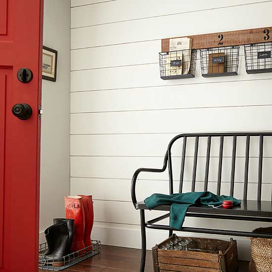 warm white painted shiplap entryway with red door and bench