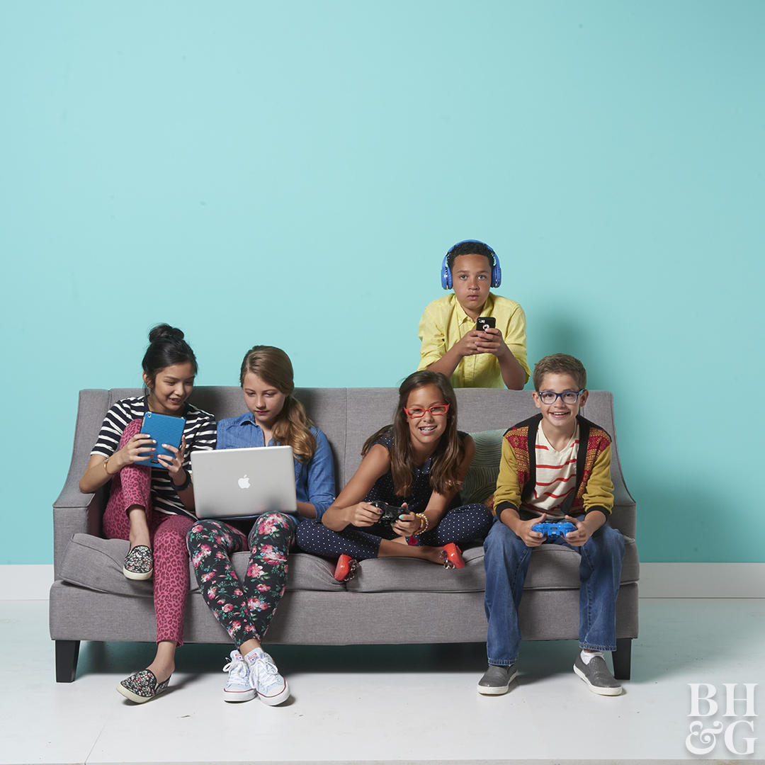 tweens and teens sitting on a couch