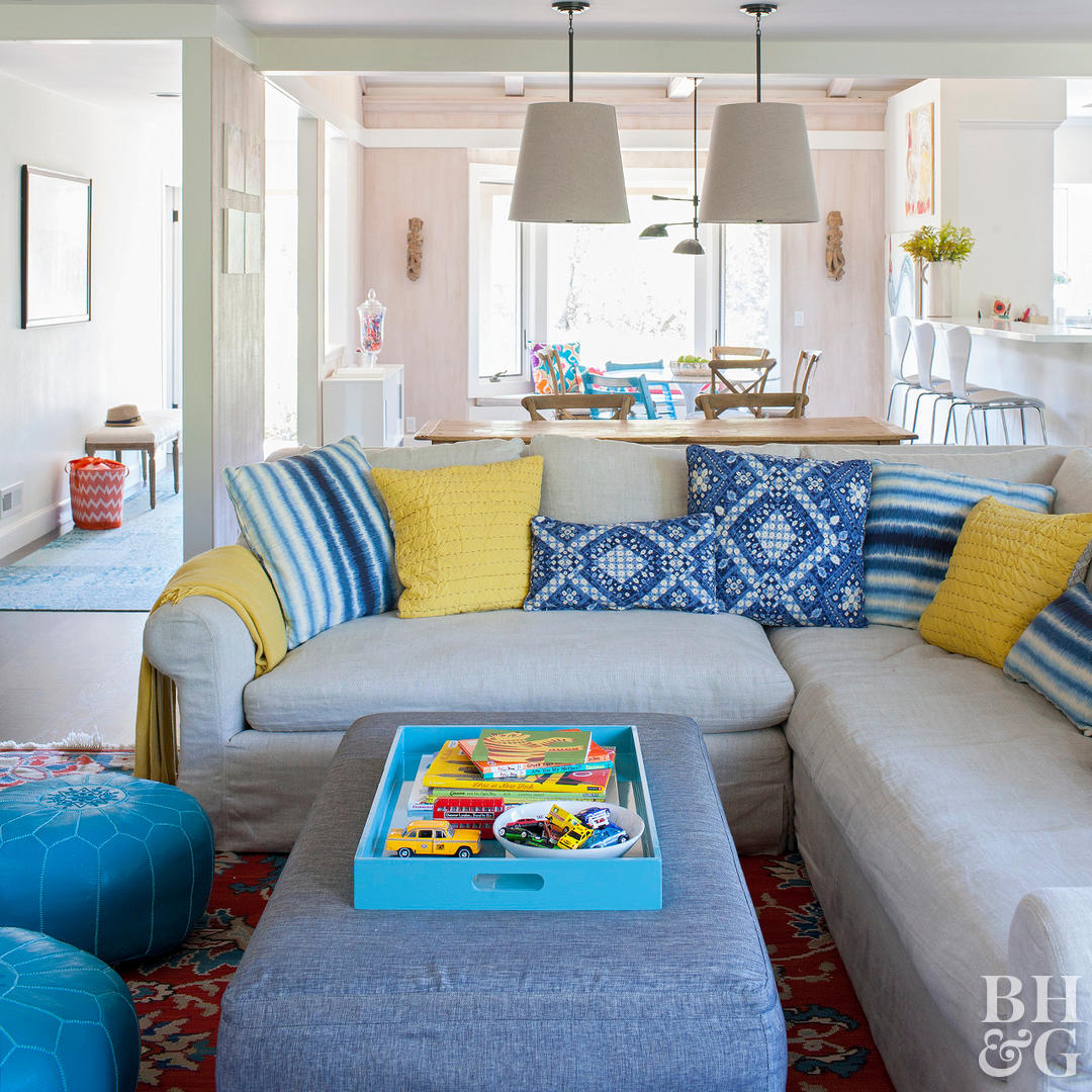 open floorplan sectional and blue ottoman